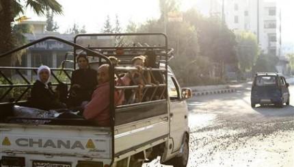 Civilians flee the violence from the Damascus suburbs of Kfarbatna